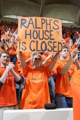 Virginia fan Susan Lee holds up a sign for former Virginia player Ralph Sampson during the final game at University Hall on March 5, 2006.