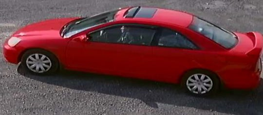 A 2001 Honda Civic driven by Hareton Jamie Rodriguez Sariol. The photo was captured by a surveillance camera, police said.