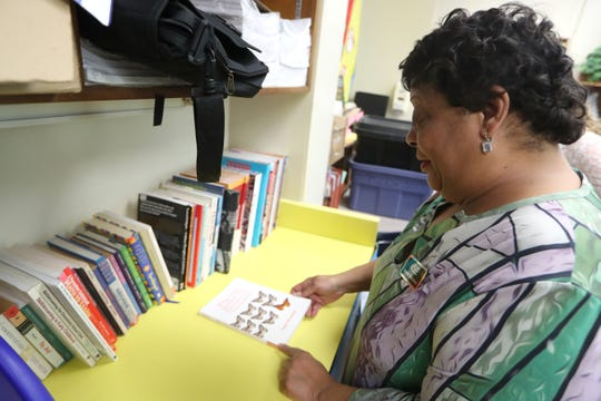 Beverly Robinson, who will be starting her last year as a teacher at Kate Sullivan Elementary School after joining the staff there in 1990, looks through her collection of books in her classroom on Friday, Aug. 10, 2018.