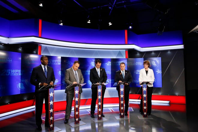 Democratic gubernatorial candidates, from left, Andrew Gillum, Jeff Greene, Chris King, Philip Levine and Gwen Graham await the start of a debate ahead of the Democratic primary for governor, Thursday, Aug. 2, 2018, in Palm Beach Gardens.