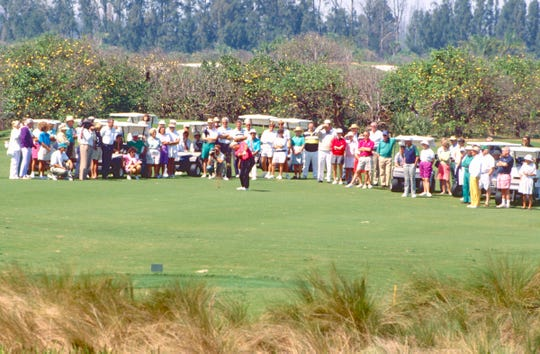 A crowd watches Arnold Palmer as he tries the new Orchid Island Golf and Beach Club course on March 19, 1991. Palmer played a round of golf on the course, one of 164 his Palmer Course Design Co. had developed at that time. About 100 members and invited guests followed him around the course.