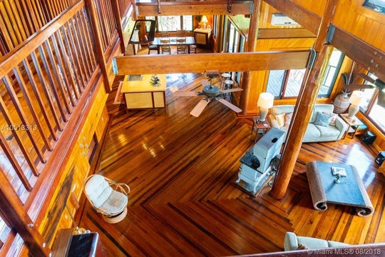 View from the second floor walkway into the living room of this Grant Island home.