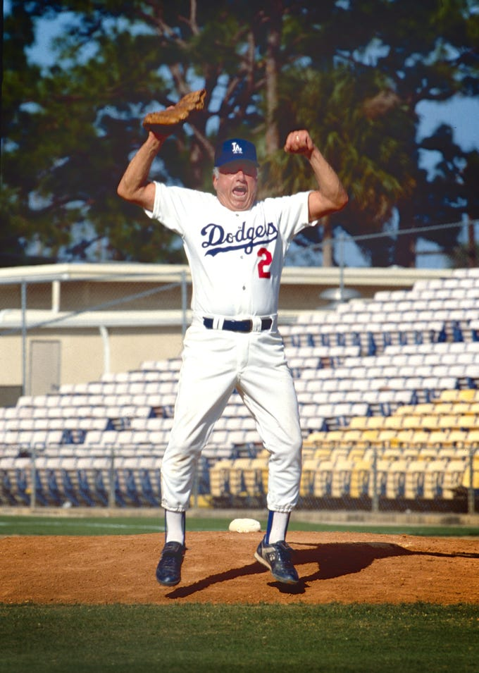 February 20, 1991 - Los Angeles Dodgers manager Tommy Lasorda celebrates his team's double play in the final game of the Dodgers Adult Baseball Camp at Holman Stadium. Lasorda pitched seven shut-out innings and also stole a base for the camp instructors who beat the campers 16-2. The first plane-load of Los Angeles Dodgers arrived later that day at the Vero Beach Municipal Airport for the beginning of the spring training season.