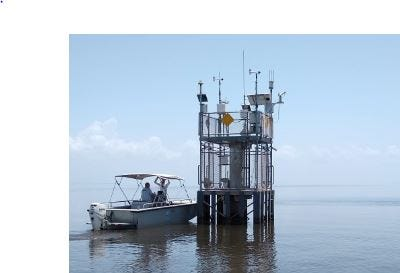 Staffers from Harbor Branch Oceanographic Institute prepare Thursday, Aug. 9, 2018, to install a SeaPRISM algae monitor on a platform in the middle of Lake Okeechobee.