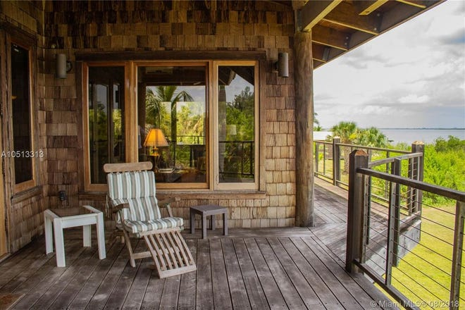 Catch the sunrise from the balcony at this Grant Island home.