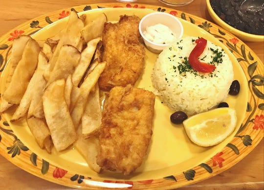 Luso Portuguese Grille's fish and chips was New Bedford cod filet lightly battered and deep fried with tartar sauce on the side. It was accompanied by black beans and rice as well as fries.
