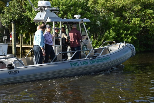 Florida Governor Rick Scott and Senator Joe Negron tour the algae affected areas of the St. Lucie River from a Florida Fish and Wildlife Conservation boat on Friday, August 10, 2018, in Stuart.