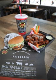 Fatburger's large burger with the works and Buffalo's Express' boneless Asian Sesame Chicken Wings are two of their most popular items. Fatburger & Buffalo's Express has a new location in Thousand Oaks on Moorpark Road. It is the only Fatburger/Buffalo's Express in Ventura County.
