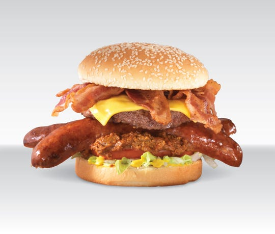Famous for its hot dogs, Pink's also serves burgers. Its Jaws burger is made with chili, cheese, a hamburger patty, a Polish dog and several strips of bacon.