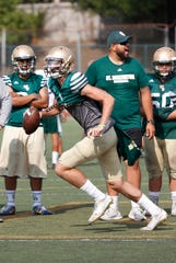 St. Bonaventure quarterback Gavin Beerup rolls out while looking for an open receiver during Thursday's practice.