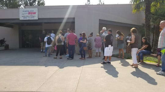 Long lines form outside the Thousand Oaks DMV office Thursday as walk-in customers prepare for an hours-long wait for service.