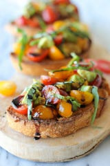 The perfect midday treat or party time tapa, with ripe avocado and juicy grape tomatoes.