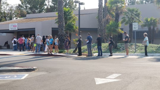 Long lines form outside the Thousand Oaks DMV office recently.