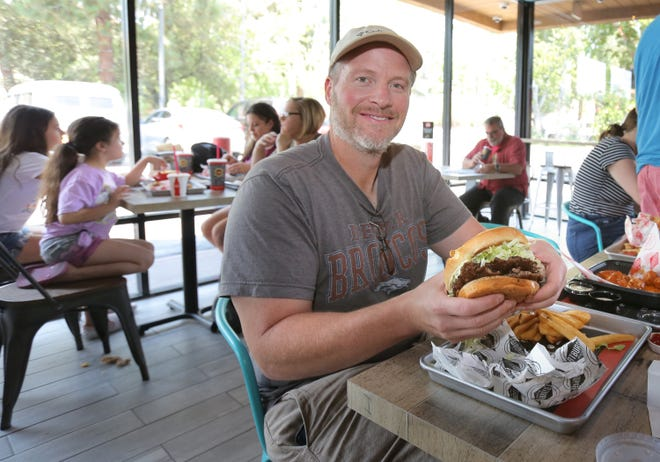 Rich Rogers gets ready to try out the XXL Burger at the newly opened Fatburger & Buffalo's Express in Thousand Oaks. Rogers, who is from Mission Viejo, was on his way up north and stopped by the restaurant to have a burger with friends.