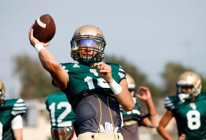 St. Bonaventure quarterback Kai Rojas gets ready to loft a pass during Thursday's practice.