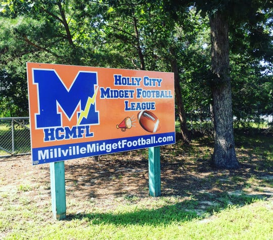 A sign for the Holly City Midget Football League outside Lakeside Middle School.
