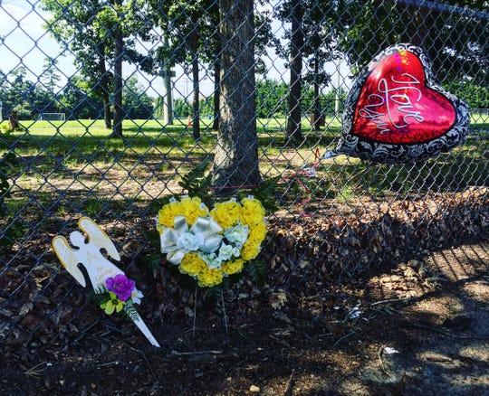 A small makeshift memorial outside Lakeside Middle School in Millville, where Joseph L. Jones was fatally shot on Thursday night, Aug. 9, 2018.