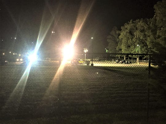 Millville police at the scene of a fatal shooting behind Lakeside Middle School in the rear parking lot Thursday night.