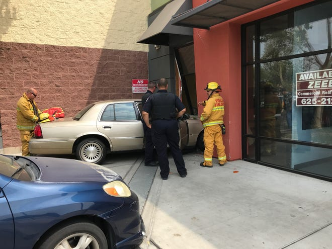 A car crashed into a vacant storefront around 2:30 p.m. Friday next to the WinCo Foods shopping center on West Caldwell Avenue.