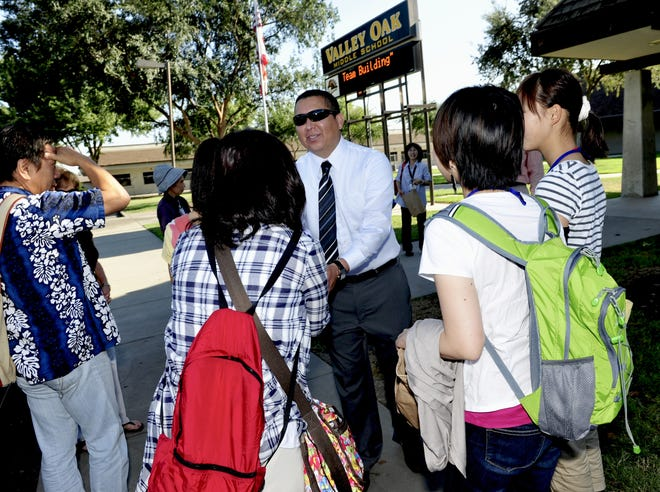 In this file photo, former Valley Oak Principal Michael Hernandez greets campus visitors. Hernandez resigned from his position at the school on August 6, 2018.