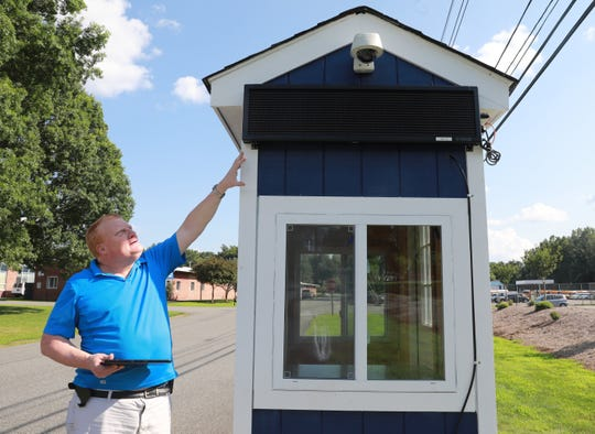 Ron Hansen, director of financial operations, at Rockland BOCES. points to the camera and light-emitting diode screen that is part of the new security gate at the school in West Nyack.