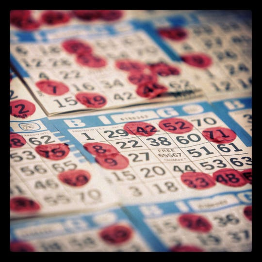 Police say two women from Camden attempted to win a bingo game at a Runnemede church by taping a number onto the card.