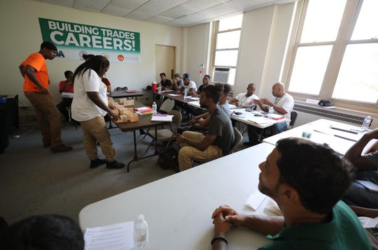 Instructor Duane Townes looks on as students work on a task of lining up measurements, during a Yonkers Industrial  Development Agency pre-apprenticeship class being taught by Pathways to Apprenticeship in Yonkers, Aug. 10, 2018.