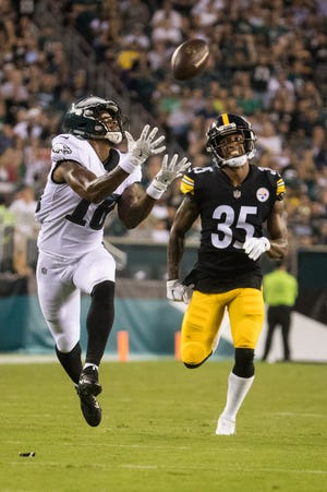 Eagles receiver Shelton Gibson hauls in a 63-yard touchdown pass from quarterback Nate Sudfeld in the second quarter in the Eagles' preseason opener Thursday night. Steelers CB Dashaun Gibson is trailing the play.