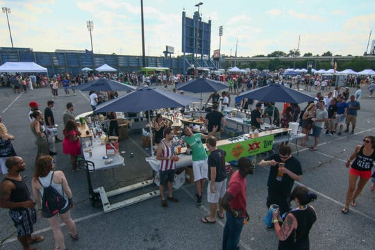 Hundreds of people eat and drink at the Delaware Taco Festival at Frawley Stadium in Wilmington.