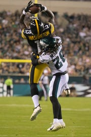 Pittsburgh's James Washington (13) makes a reception despite the efforts of Philadelphia's Avonte Maddox (29) Thursday at Lincoln Financial Field.