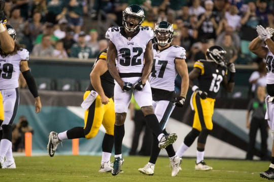 Eagles' Rasul Douglas (32) celebrates after making an interception Thursday at Lincoln Financial Field.