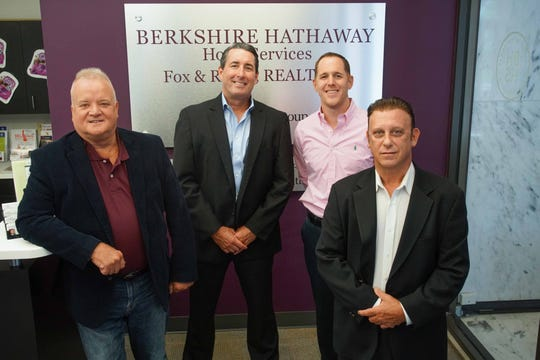 (left tor right)Ed Breland, vice president, Walt Hurtt, sales manager, vice president,  Brian George, manager of Greenville office, and Anthony Sianni, manager-vice president for residential, commercial, land and new construction sales, all for Berkshire Hathaway HomeServices Fox & Roach that placed 3rd for a Mid-size company in this years Top Workplaces.