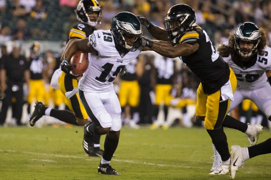 Eagles' Rashard Davis (19) looks for a way through the Steelers defense Thursday at Lincoln Financial Field.