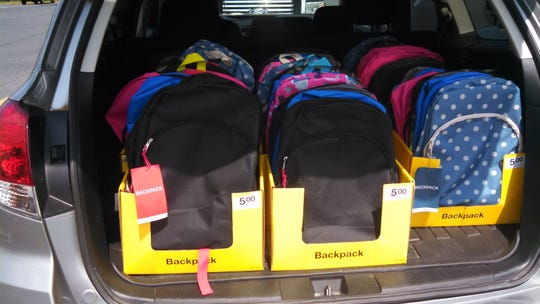 Backpacks are donated by Gerald Hocker and the Southern Sussex Rotary Club for a school supplies drive at G.W. Carver Academy in Frankford.