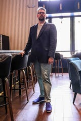 """Gavin Bish wears a Breton striped tee by J Crew, sage chinos by Lands End, navy linen jacket by Jos A Bank and blue """"Stitch Lite"""" Oxfords by Cole Haan."""