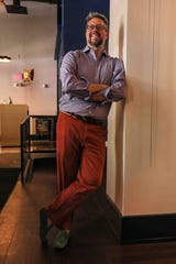 Gavin Bish wears a lavender dress shirt by Van Heusen, red chinos by Ralph Lauren and green suede driver's loafers by New Republic.