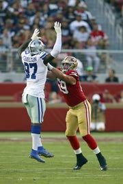 San Francisco 49ers tackle Mike McGlinchey (69) blocks Taco Charlton of the Dallas Cowboys during an NFL football game Thursday, Aug. 9, 2018, in Santa Clara, CA. The Niners won 24-21.