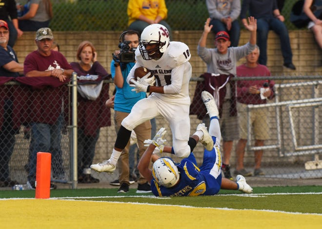 John Glenn's Joseph Clifford leaps into the end zone against Philo last season. The senior wide receiver-defensive back highlights a strong senior class for the Muskies, who are coming off a final four appearance.