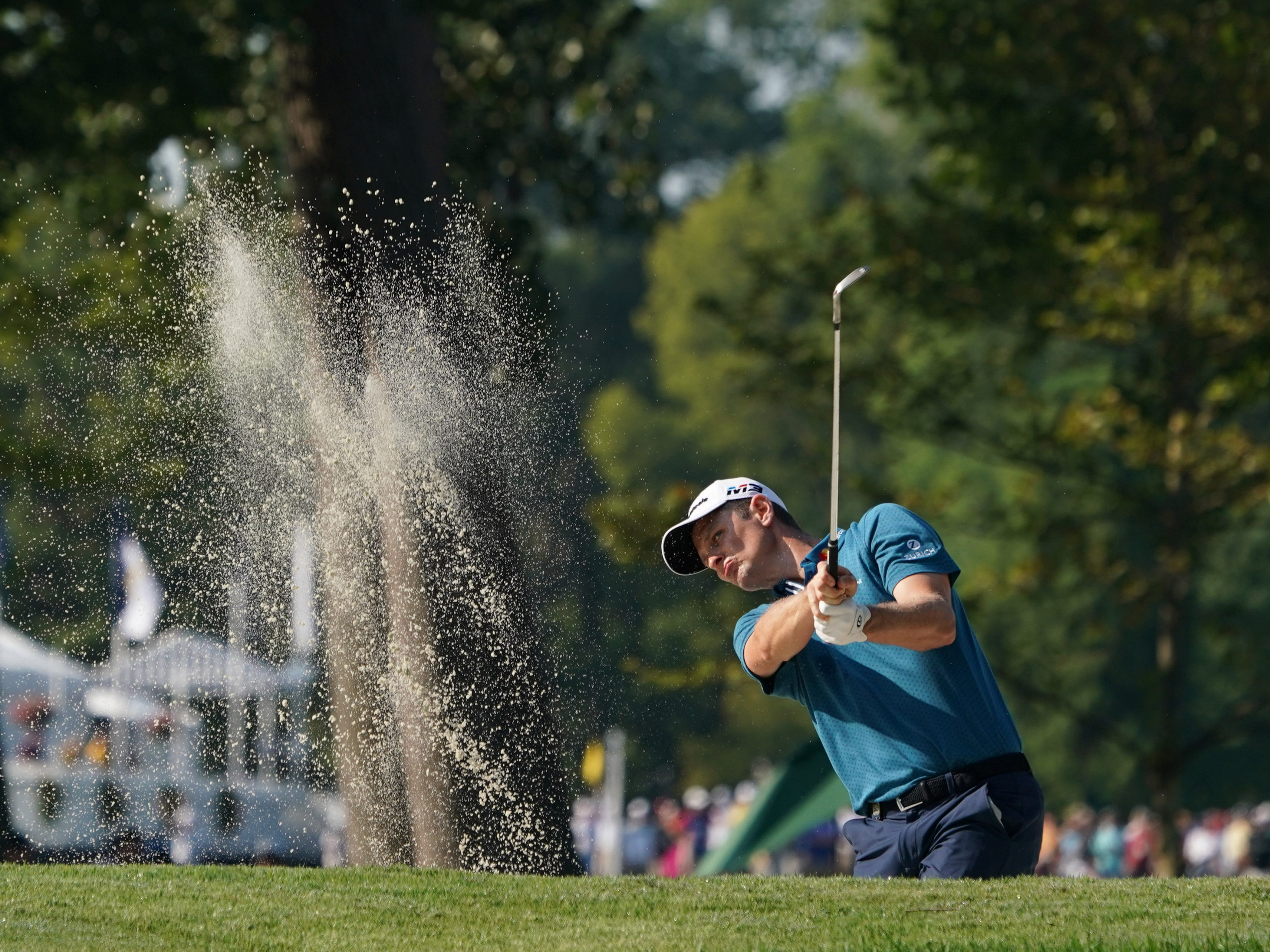 Justin Rose hits out of a bunker on the 12th hole during the second round.