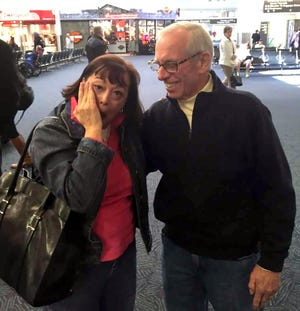 Tom Peters of Brookfield, Wis., right, and his daughter, Mary Jane Millehan of Roanoke, Va., were reunited in 2015, for the first time in 51 years, at Mitchell International Airport in Milwaukee.