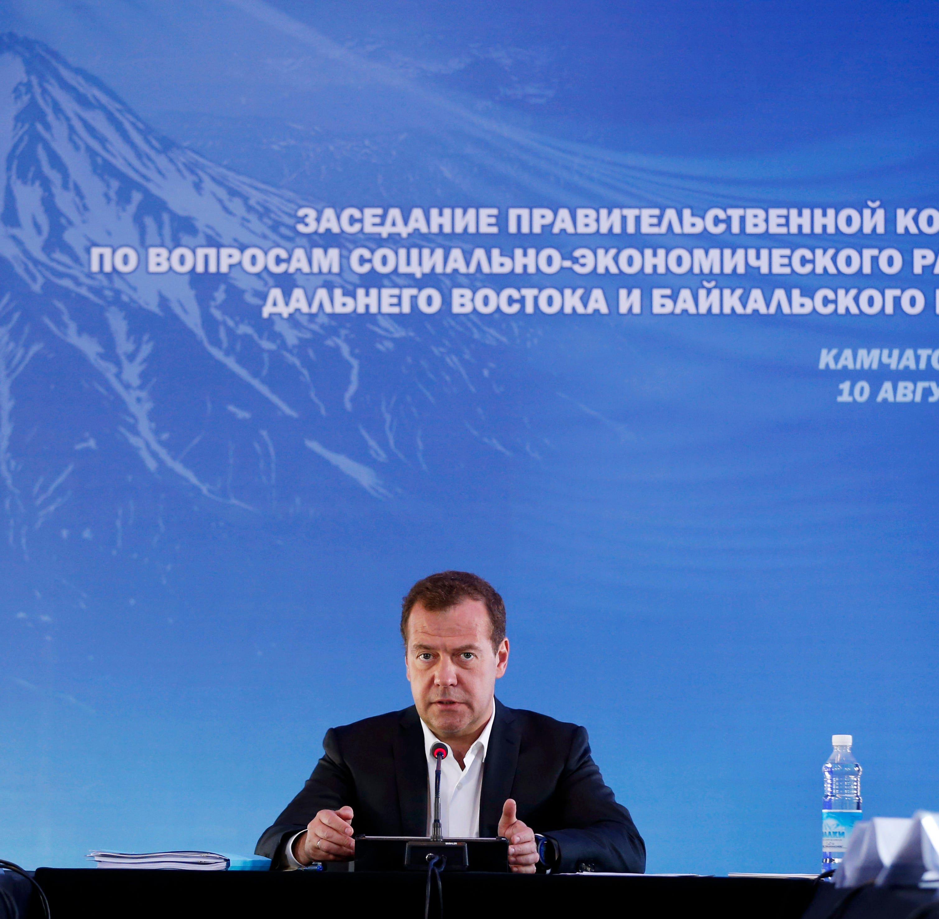 """Russian Prime Minister Dmitry Medvedev speaks during a meeting in Kamchatka Peninsula region, Russian Far East, Russia,  Aug. 10, 2018. Russia's prime minister warned the United States  against ramping up sanctions, saying that Moscow will retaliate with economic, political and unspecified """"other"""" means."""