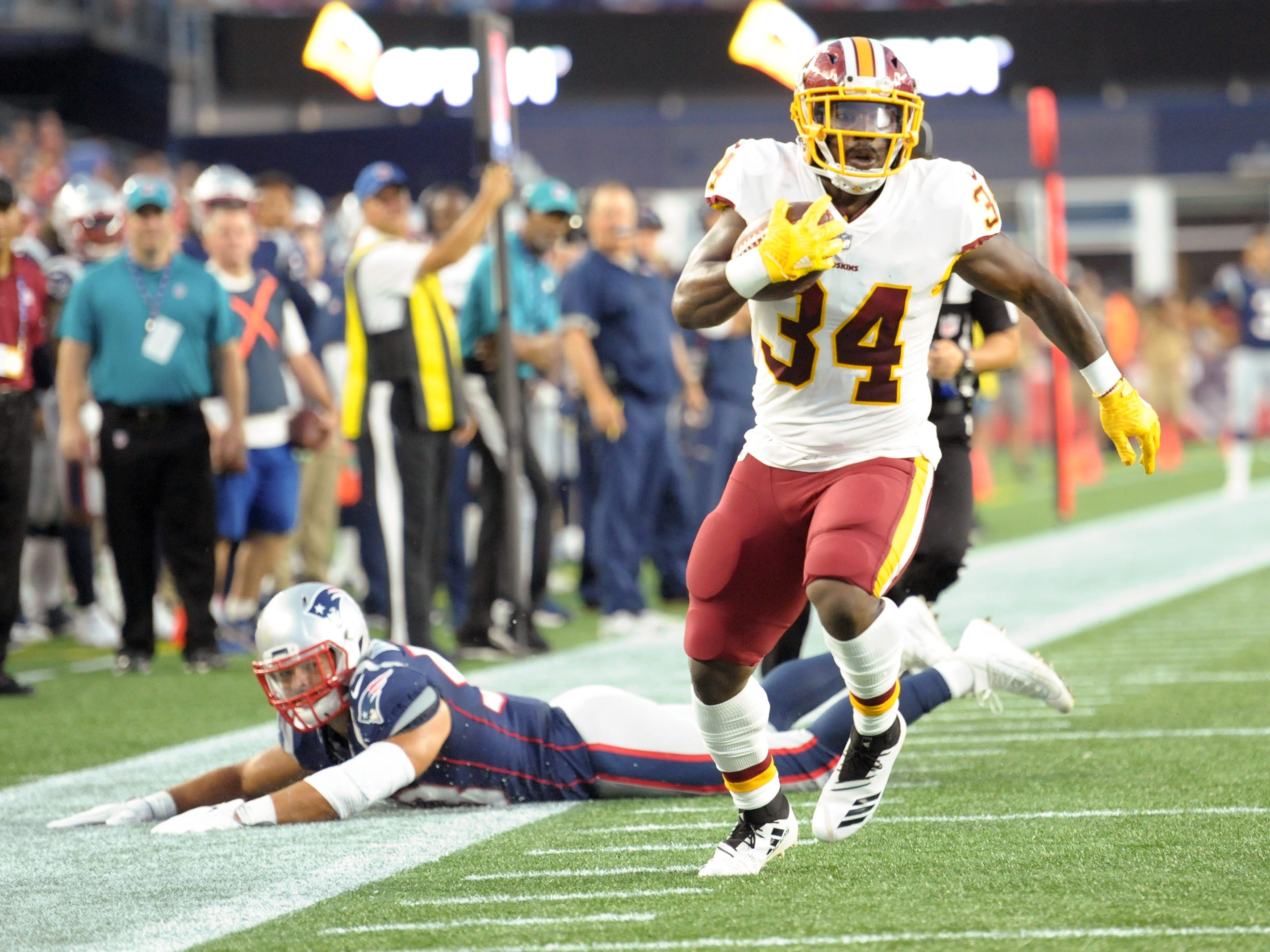 Washington Redskins running back Byron Marshall (34) scores a touchdown during the first half against the New England Patriots at Gillette Stadium.