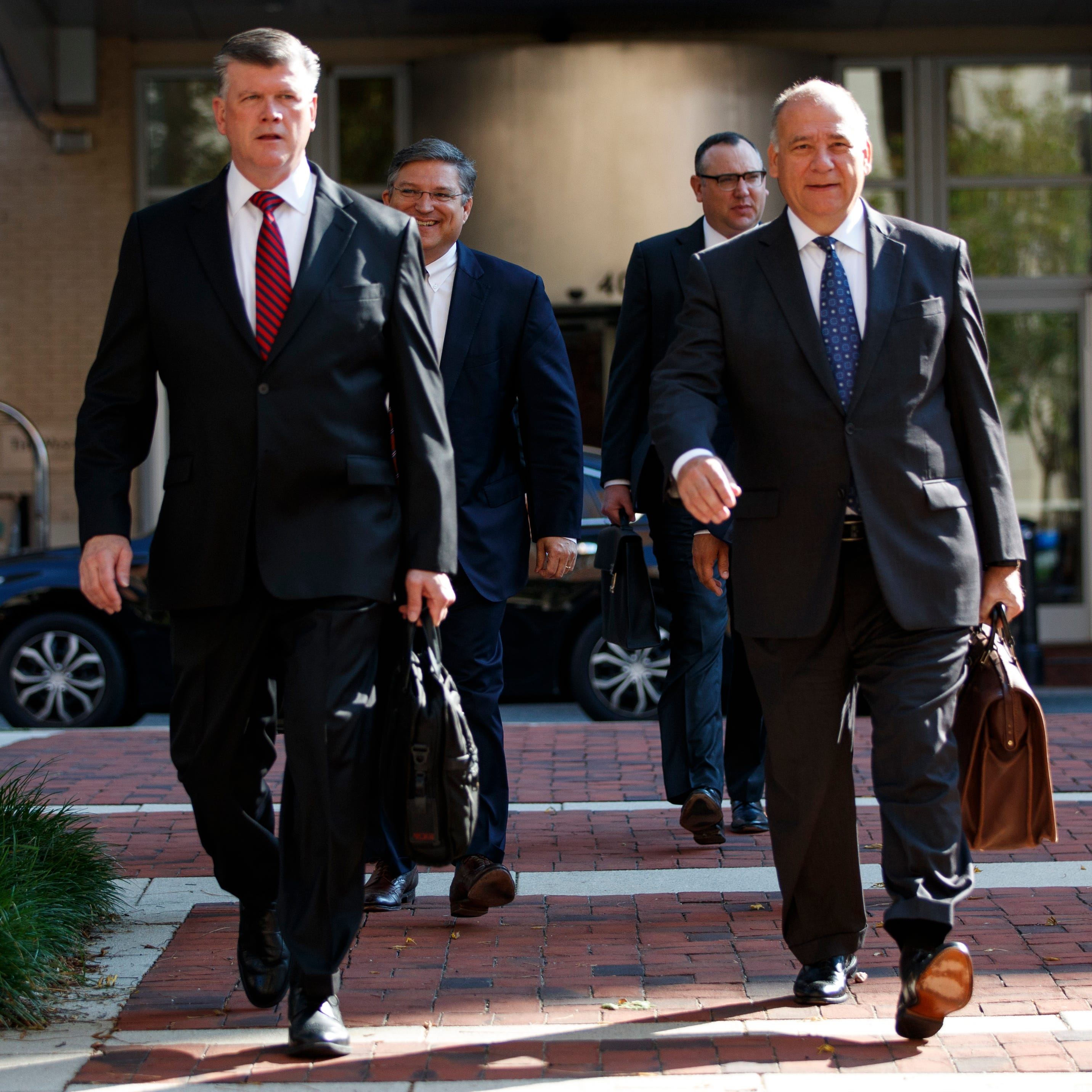 The defense team for Paul Manafort, including Kevin Downing left and Thomas Zehnle, arrive at the Albert V. Bryan United States Courthouse for the trial of former Trump campaign chairman, Friday in Alexandria, Va.