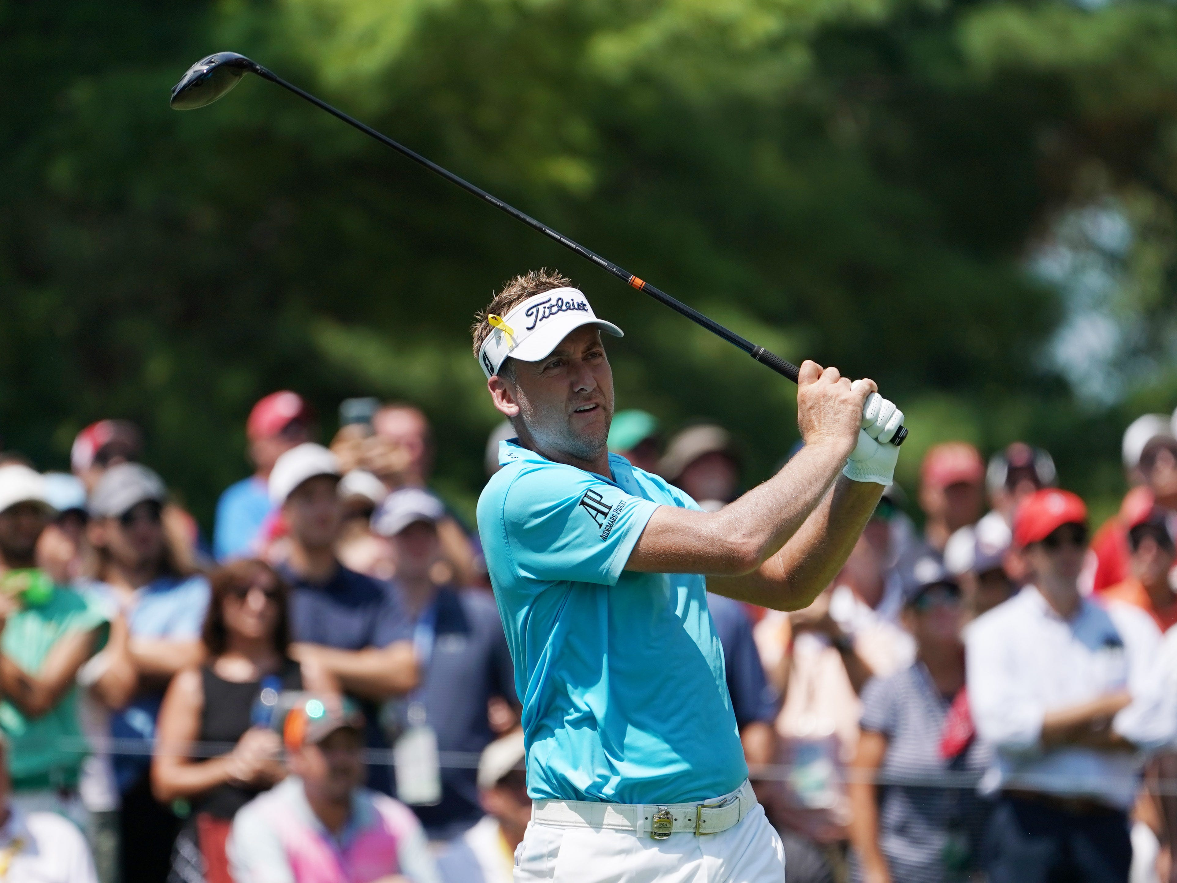 Ian Poulter hits his tee shot on the 4th hole during the second round.