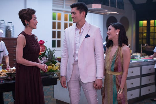 "Nick (Henry Golding) introduces his girlfriend Rachel (Constance Wu) to his overbearing mom (Michelle Yeoh) in ""Crazy Rich Asians."""