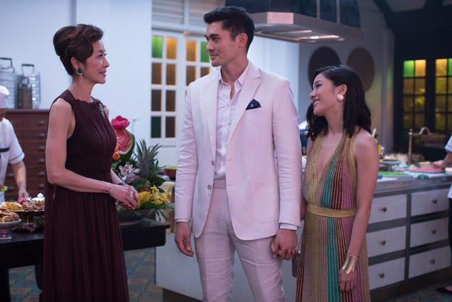 """Nick (Henry Golding) introduces his girlfriend Rachel (Constance Wu) to his overbearing mom (Michelle Yeoh) in """"Crazy Rich Asians."""""""
