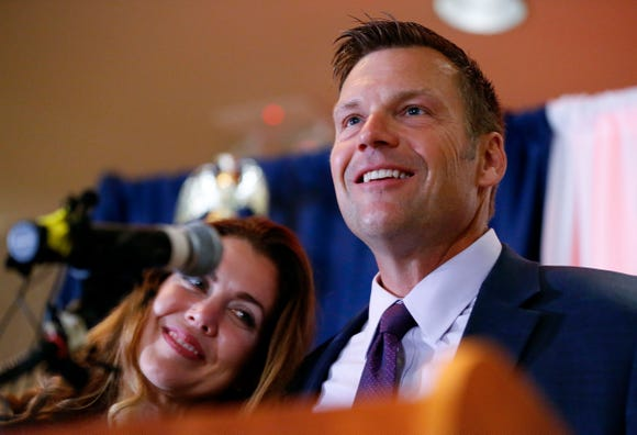 Kansas Republican gubernatorial candidate Kris Kobach and his wife Heather take the stage to thank their supporters.