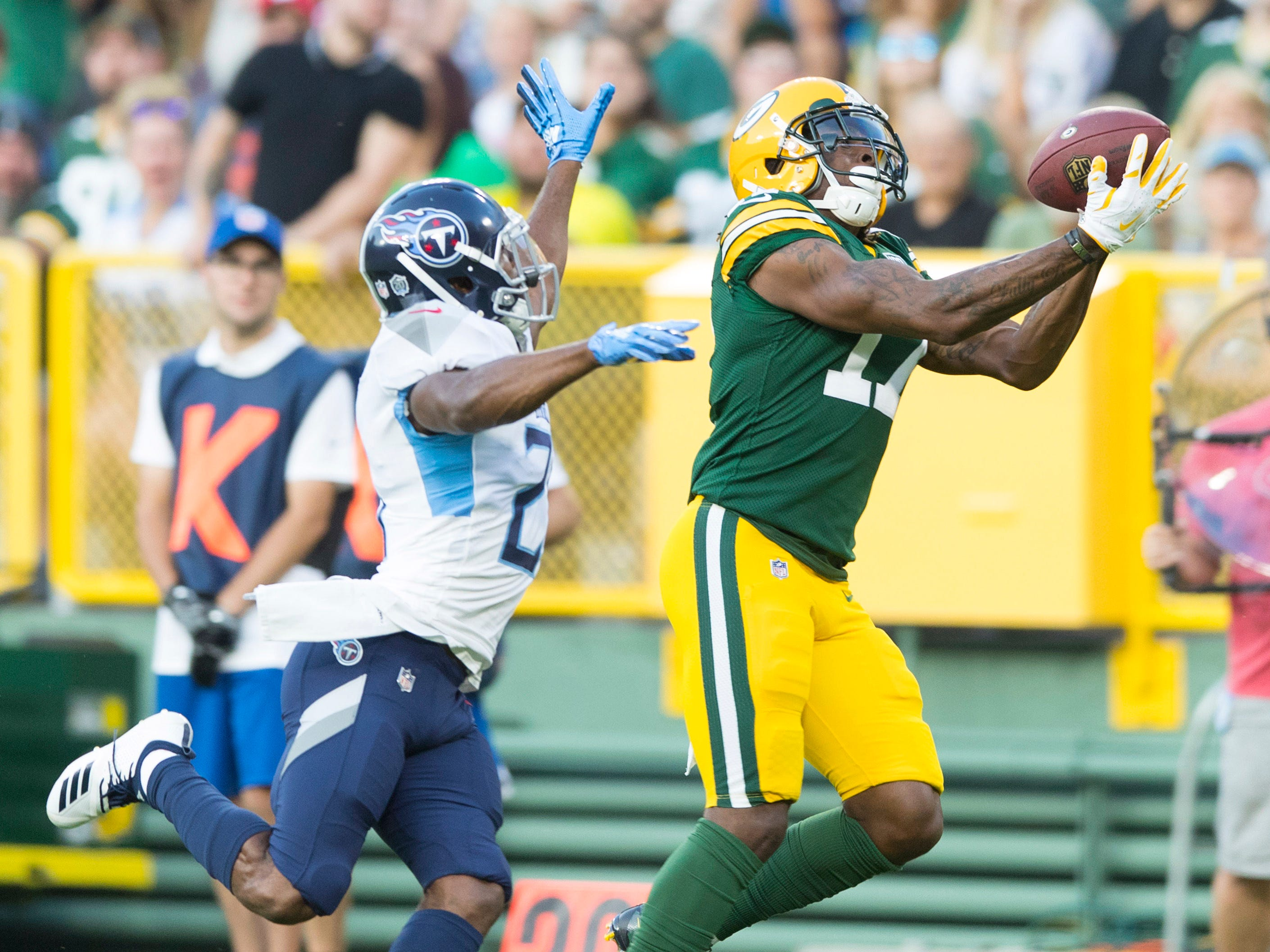 Green Bay Packers wide receiver Davante Adams (17) catches a pass during the first quarter against the Tennessee Titans at Lambeau Field.