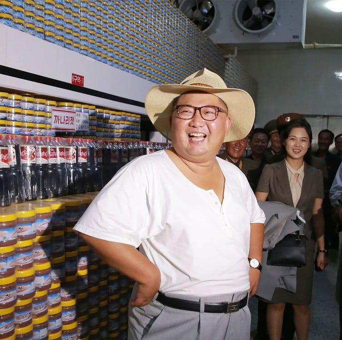 This undated picture released by North Korea's official Korean Central News Agency (KCNA) on August 8, 2018, shows North Korean leader Kim Jong Un  inspecting the Kumsanpho Fish Pickling Factory in North Korea.
