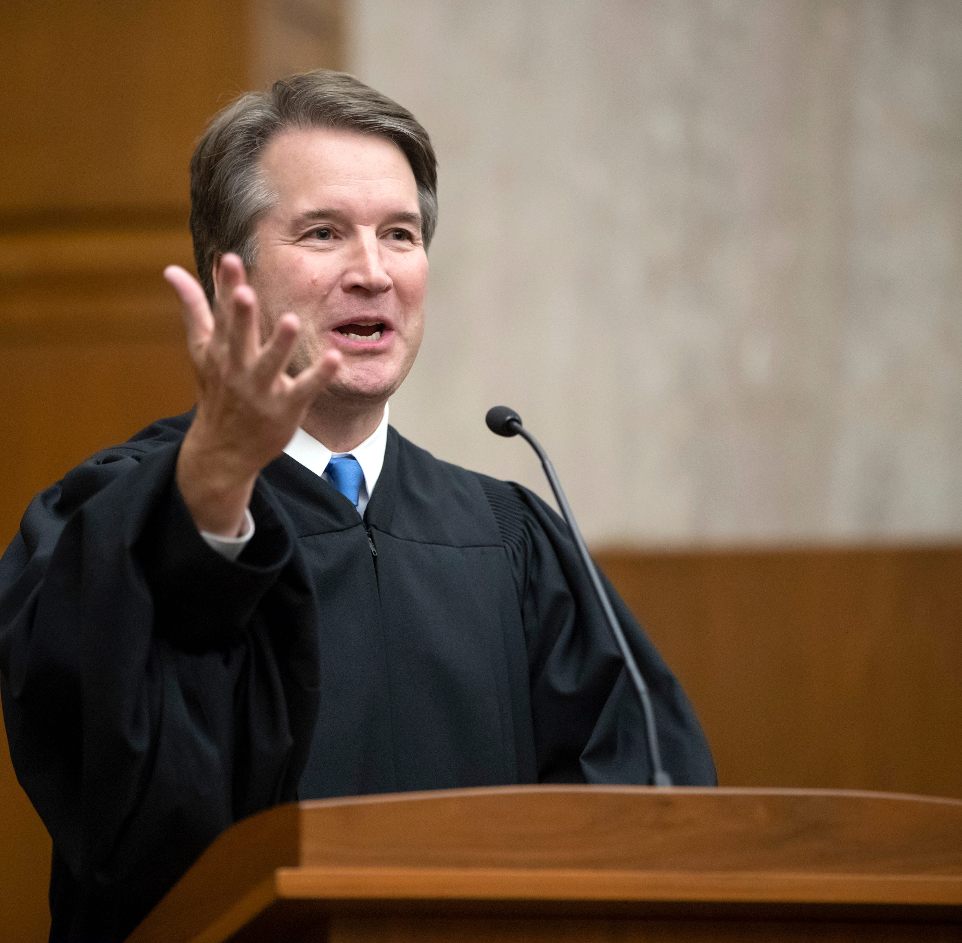 President Donald Trump's Supreme Court nominee, Judge Brett Kavanaugh, speaks as he officiates at the swearing-in of Judge Britt Grant to take a seat on the U.S. Court of Appeals for the 11th Circuit on Tuesday, Aug. 7.
